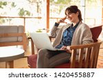 woman working on a laptop on a... | Shutterstock . vector #1420455887