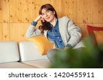 beautiful woman sitting and... | Shutterstock . vector #1420455911