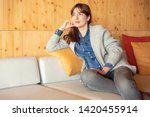 beautiful woman sitting and... | Shutterstock . vector #1420455914