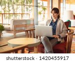 woman working on a laptop on a... | Shutterstock . vector #1420455917