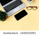 laptop placed on a yellow table ... | Shutterstock . vector #1420510391