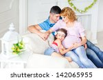 young pregnant family relaxing... | Shutterstock . vector #142065955