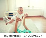 family  child and parenthood... | Shutterstock . vector #1420696127