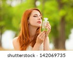 redhead girl with perfume at... | Shutterstock . vector #142069735