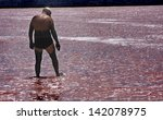man covered in mud about to... | Shutterstock . vector #142078975
