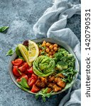 buddha bowl salad with baked... | Shutterstock . vector #1420790531