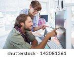 pair of photo editors working... | Shutterstock . vector #142081261