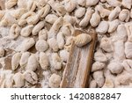 handmade gnocchi  on the table. | Shutterstock . vector #1420882847