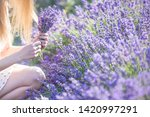 a girl with long hair collects... | Shutterstock . vector #1420997291