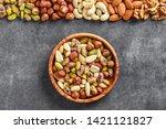 Mix Nuts On Dark Stone Table I...
