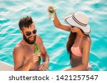 couple in love at a poolside...   Shutterstock . vector #1421257547