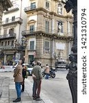 Small photo of Palermo, Italy - March 28 2018: Tourists at Quattro Canti