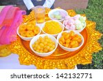 Offerings to gods in Bali with flowers, food and aroma sticks - stock photo