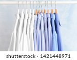 rack with clothes after dry... | Shutterstock . vector #1421448971