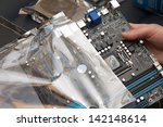 unpacking the motherboard | Shutterstock . vector #142148614