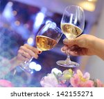 glasses with champagne in hand. | Shutterstock . vector #142155271