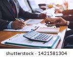 businessman team is analyzing... | Shutterstock . vector #1421581304