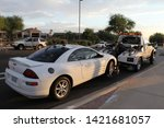 Small photo of Mesa, Ariz. / US - September 6, 2010: Cars impounded during a joint Mesa and Gilbert police Labor Day sobriety checkpoint operation are loaded for towing. 8018