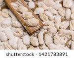 cook homemade gnocchi on the... | Shutterstock . vector #1421783891