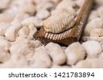 cook homemade gnocchi on the... | Shutterstock . vector #1421783894