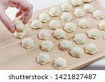 sculpt dumplings. homemade meat ...   Shutterstock . vector #1421827487