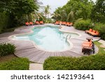 swimming pool with beach chair | Shutterstock . vector #142193641