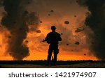 Military soldier watching helicopters and forces in battlefield  at sunset
