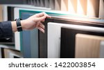 Stock photo male hand choosing cabinet panel materials or countertops for built in furniture design shopping 1422003854