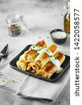 tasty stuffed pancakes crepes...   Shutterstock . vector #1422058577