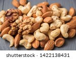 Assortment Of Nuts On Gray...