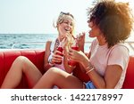 two young female friends... | Shutterstock . vector #1422178997