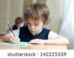 diligent preschool sitting at... | Shutterstock . vector #142225339