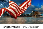 Skyline manhattan downtown and american flag flying the view New York city