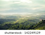 mountains under mist in the... | Shutterstock . vector #142249129