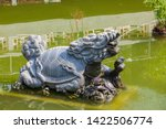 Stock photo small carved turtle stone statue fountain in chinese temple 1422506774