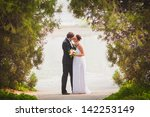 bride and groom outdoors park... | Shutterstock . vector #142253149