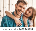 Small photo of Portrait of smiling beautiful girl and her handsome boyfriend. Woman in casual summer jeans clothes. Happy cheerful family. Female having fun on the street background