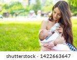Beautiful Mother Feeding Baby...