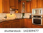 Stock photo traditional designed kitchen with wooden cabinets and granite 142309477