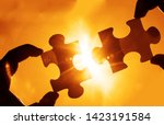 two hands trying to connect...   Shutterstock . vector #1423191584