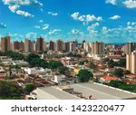 RIBEIRAO PRETO, SAO PAULO, BRAZIL - Sundown at avenue and buildings in city - Panoramic view