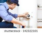 Plumber Repairing An Hot Water...