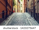 the narrow street of gamla stan ... | Shutterstock . vector #1423275647