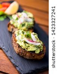 avocado toast with pickled... | Shutterstock . vector #1423327241