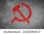 Small photo of Hammer and sickle,Communism symbol spray painted on the wall