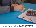 man  taking notes and... | Shutterstock . vector #1423397777