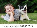 Stock photo child lovingly embraces his pet dog a blue heeler 142352014
