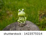 A Frog On A Rock Sculpture...