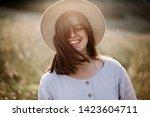 stylish girl in rustic dress... | Shutterstock . vector #1423604711