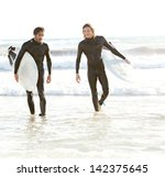 Two Young Sports Surfer Men...